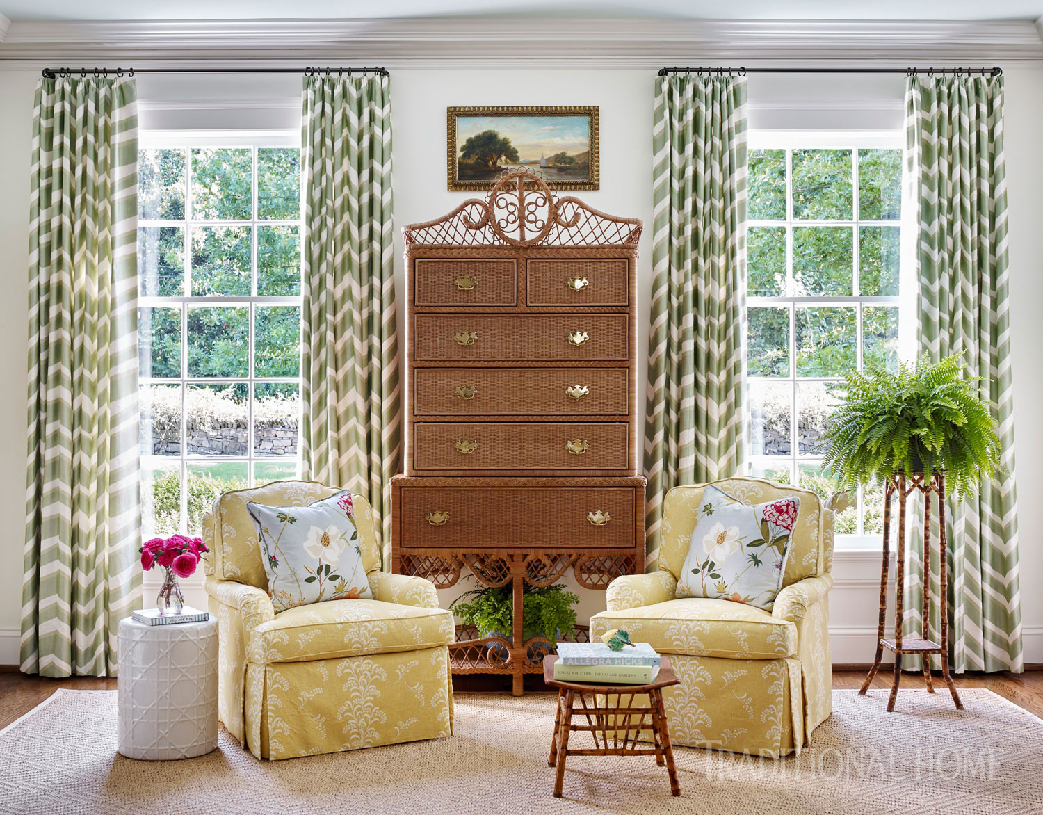 white sitting room with two yellow chairs and tall curtained windows