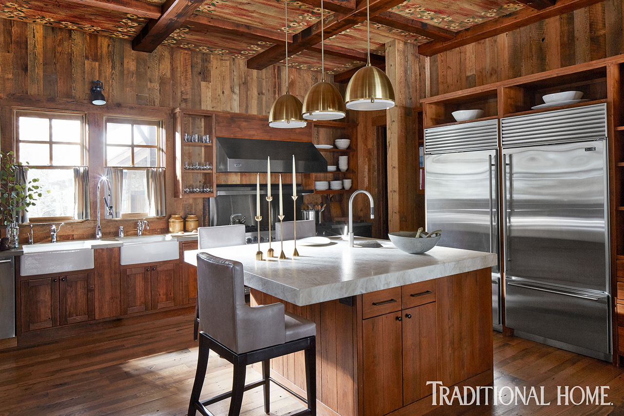 large kitchen with wood walls