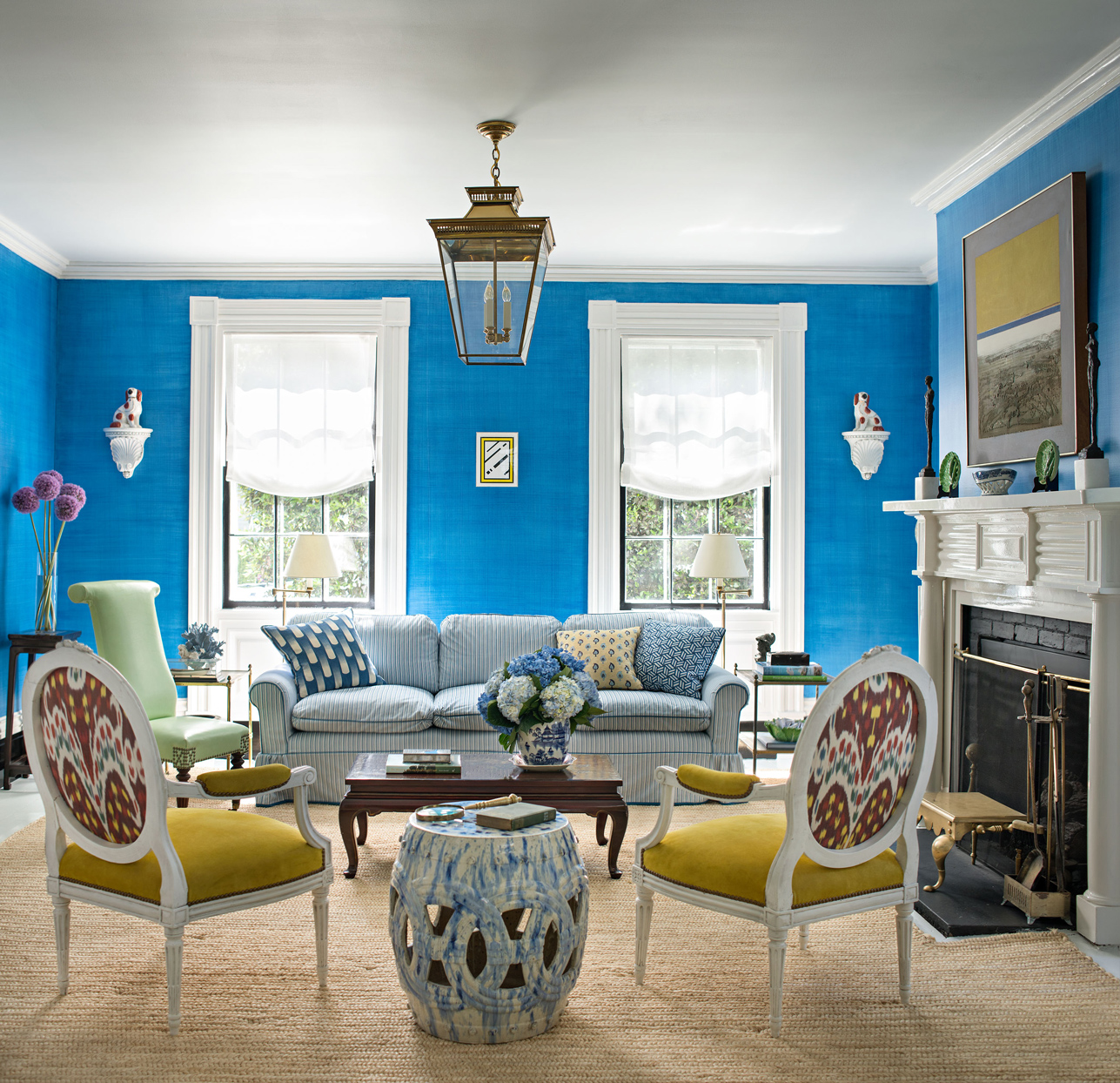 living room with blue walls and yellow chairs
