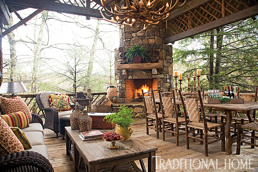 outdoor living area with stone fireplace