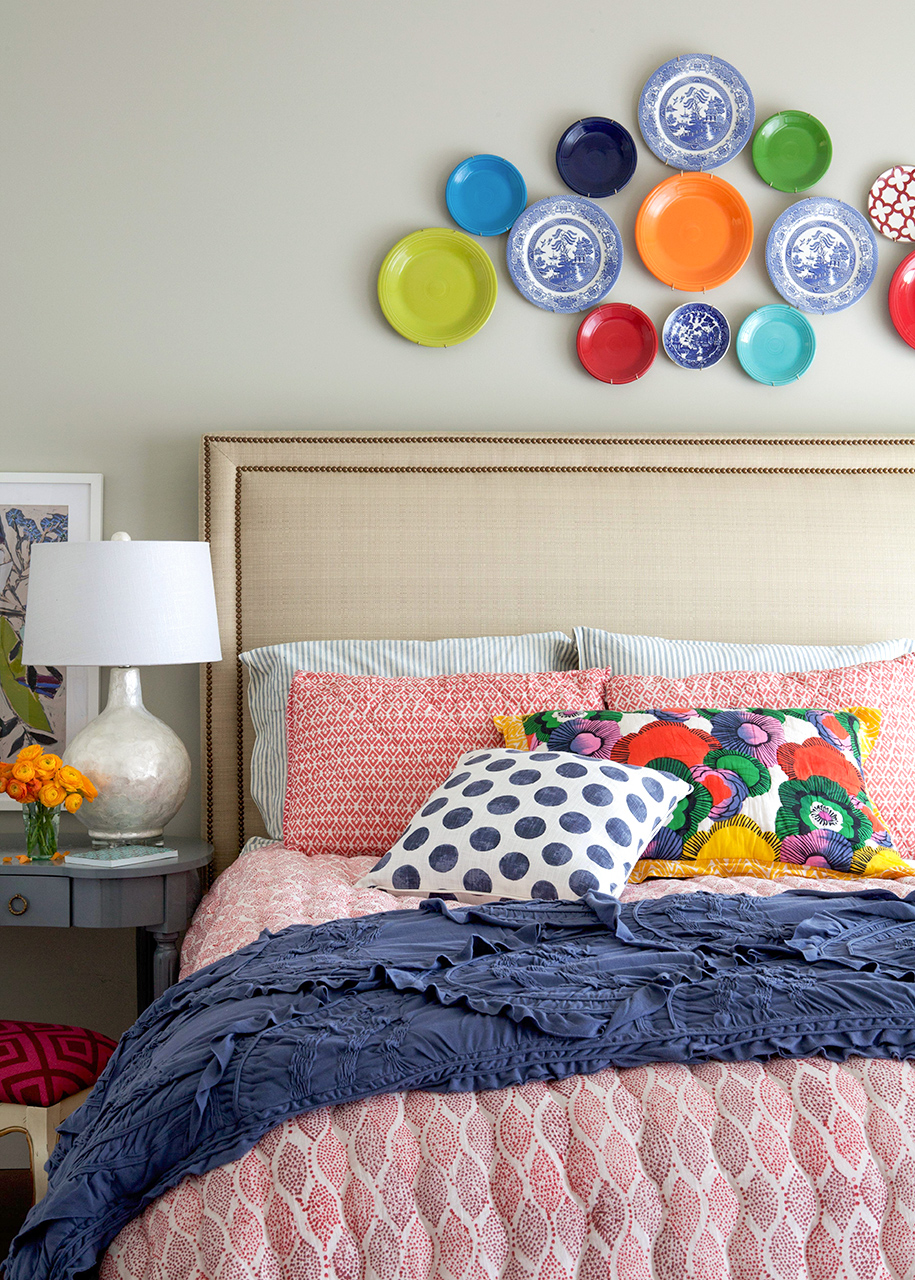 Bedroom with colored plates over bed