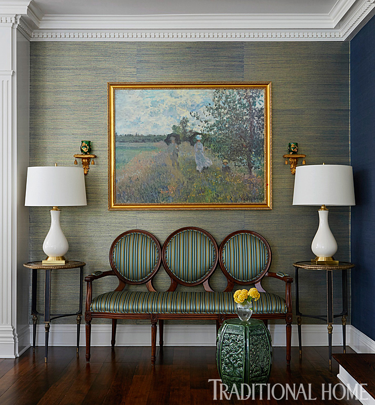 impressionist painting hanging in gray-green parlor