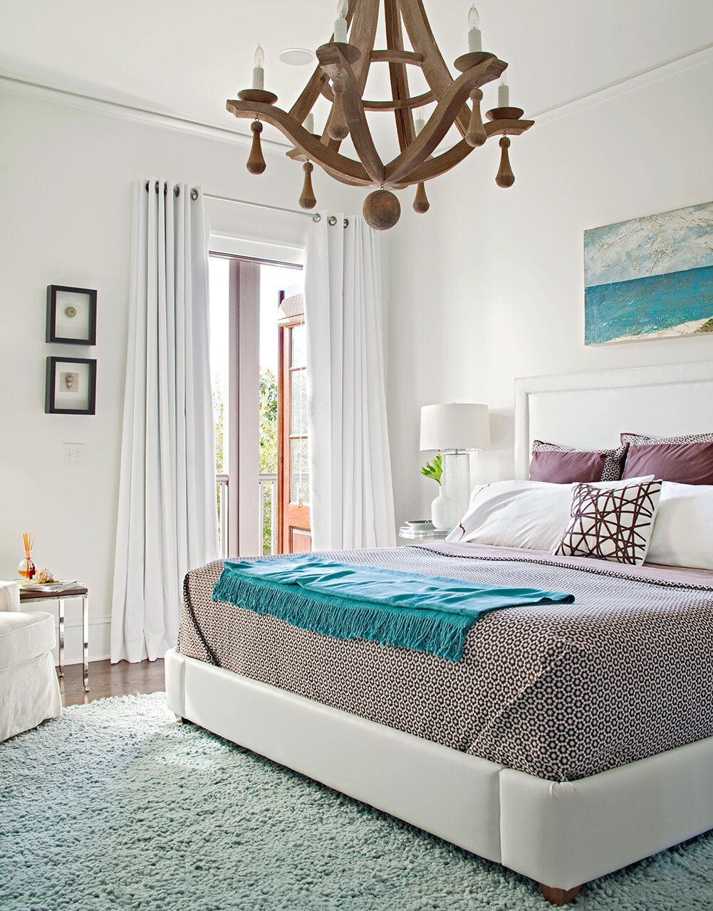 master bedroom wood chandelier blue blanket