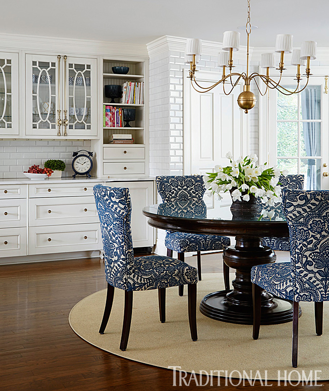 round breakfast table with blue patterned chairs