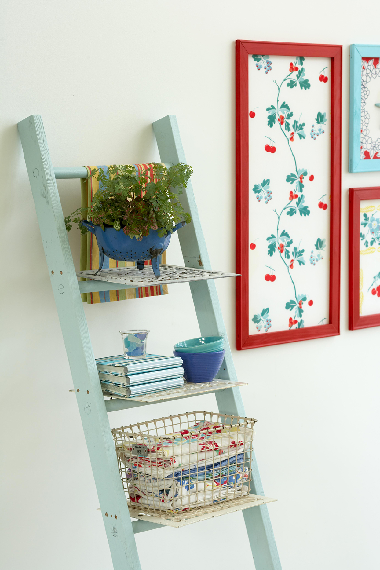ladder storage shelves with baskets and plant