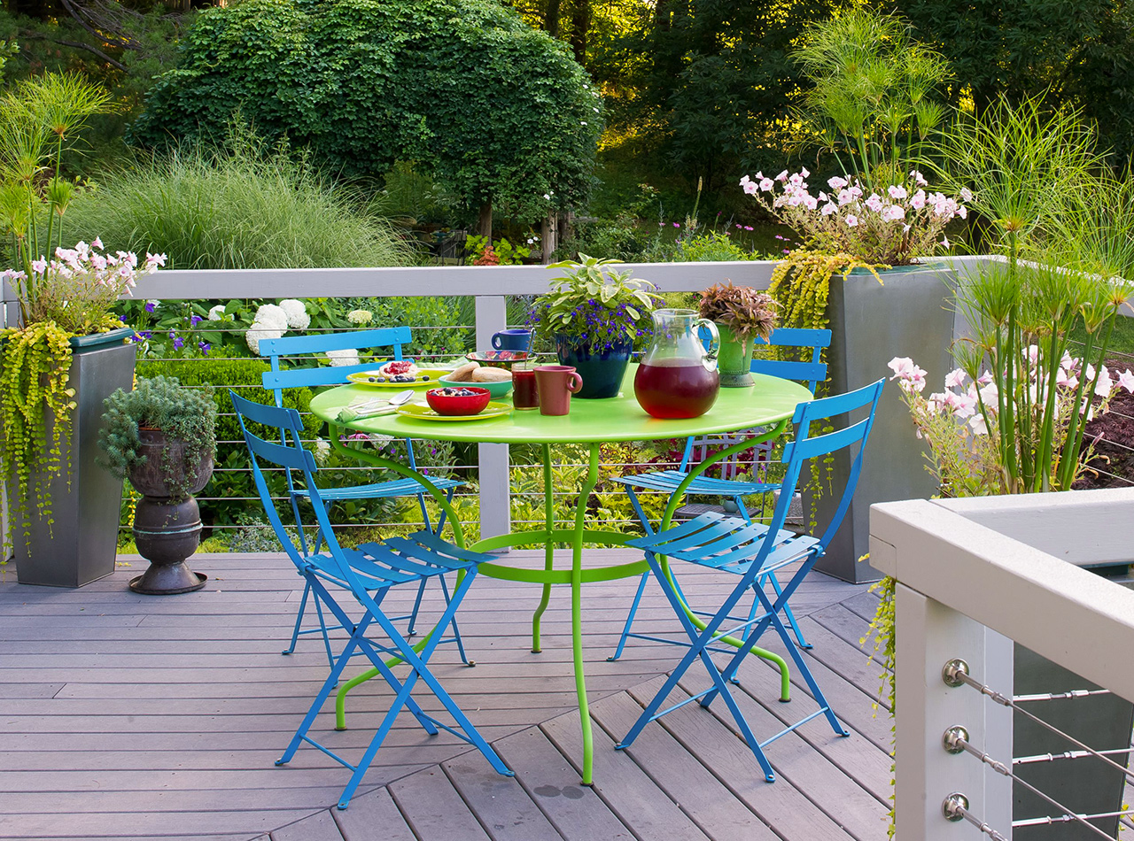 blue green table and chairs wood deck