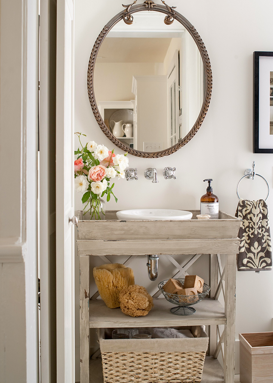 Eclectic style bathroom with distressed vanity
