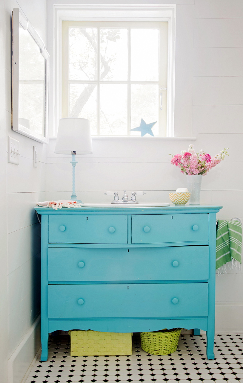 Teal dresser with green baskets and shiplap walls