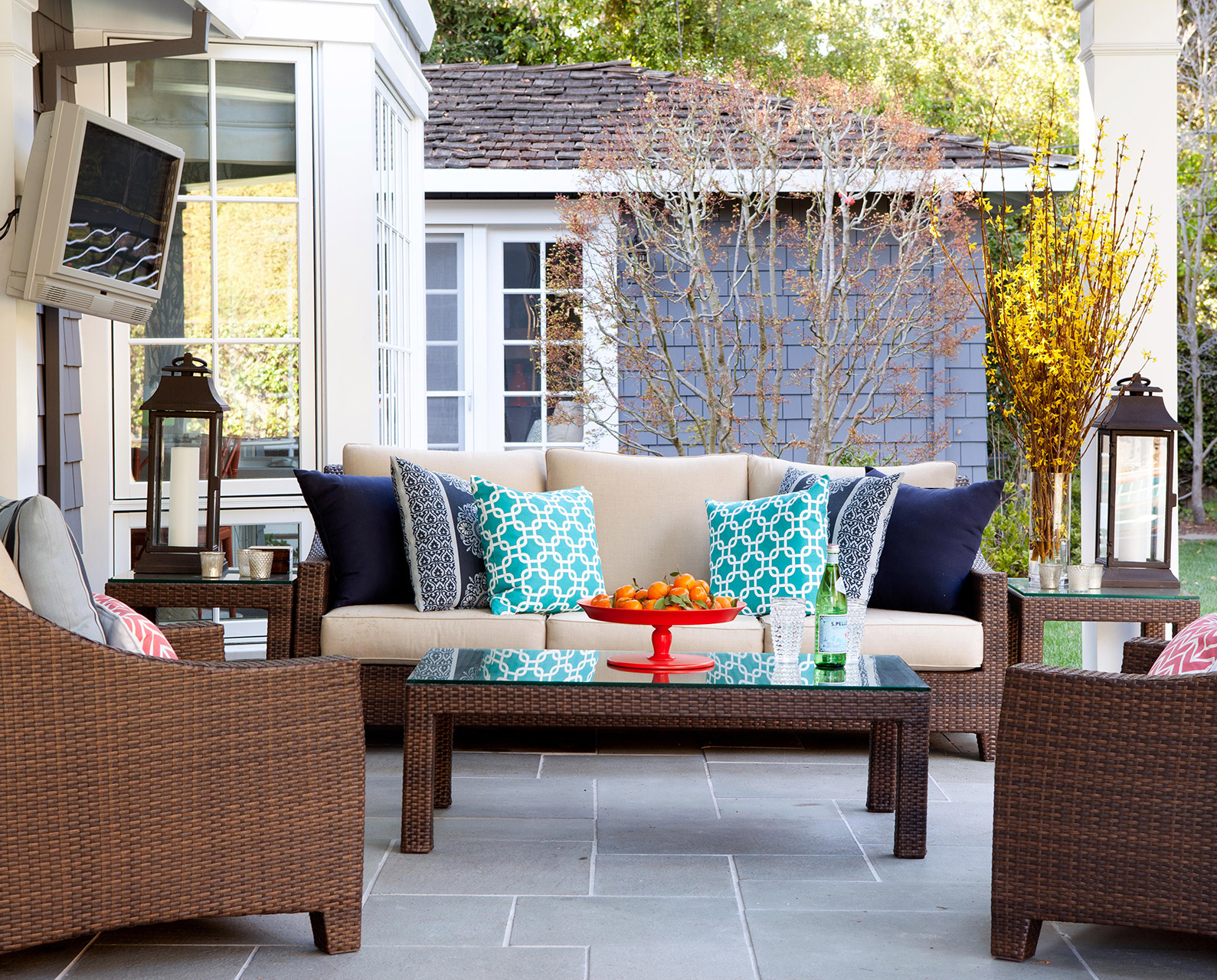 outdoor patio with stone flooring and rattan furniture