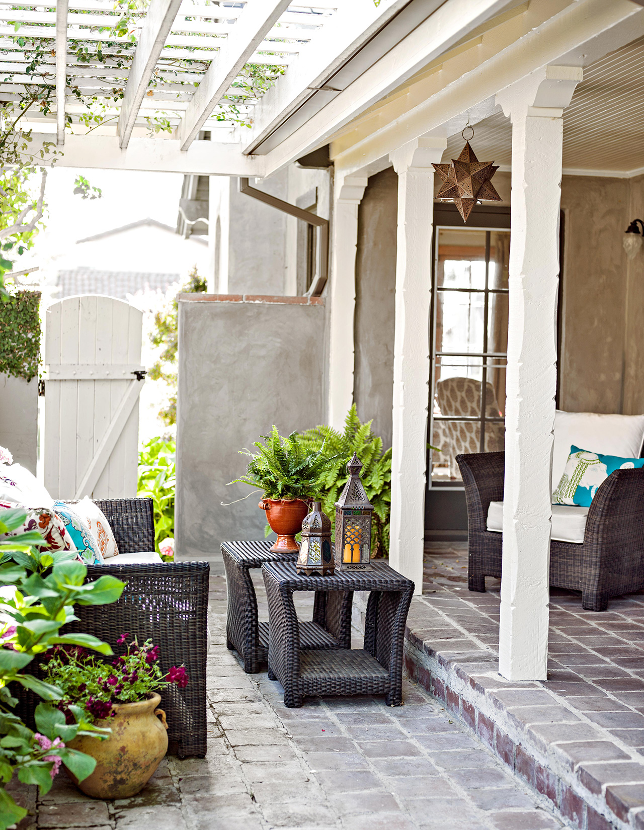 porch and patio with black wicker furniture