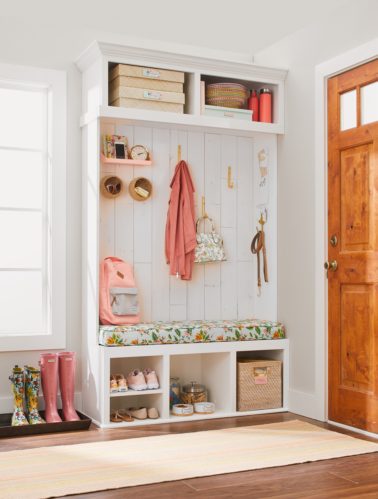 white shelving with floral print bench entryway