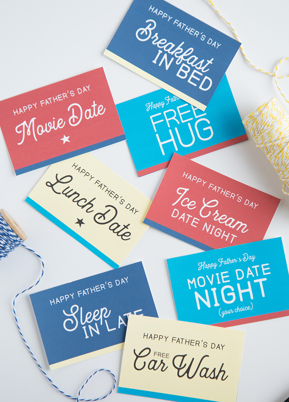 Father's Day Coupons with thread and scissors on white background
