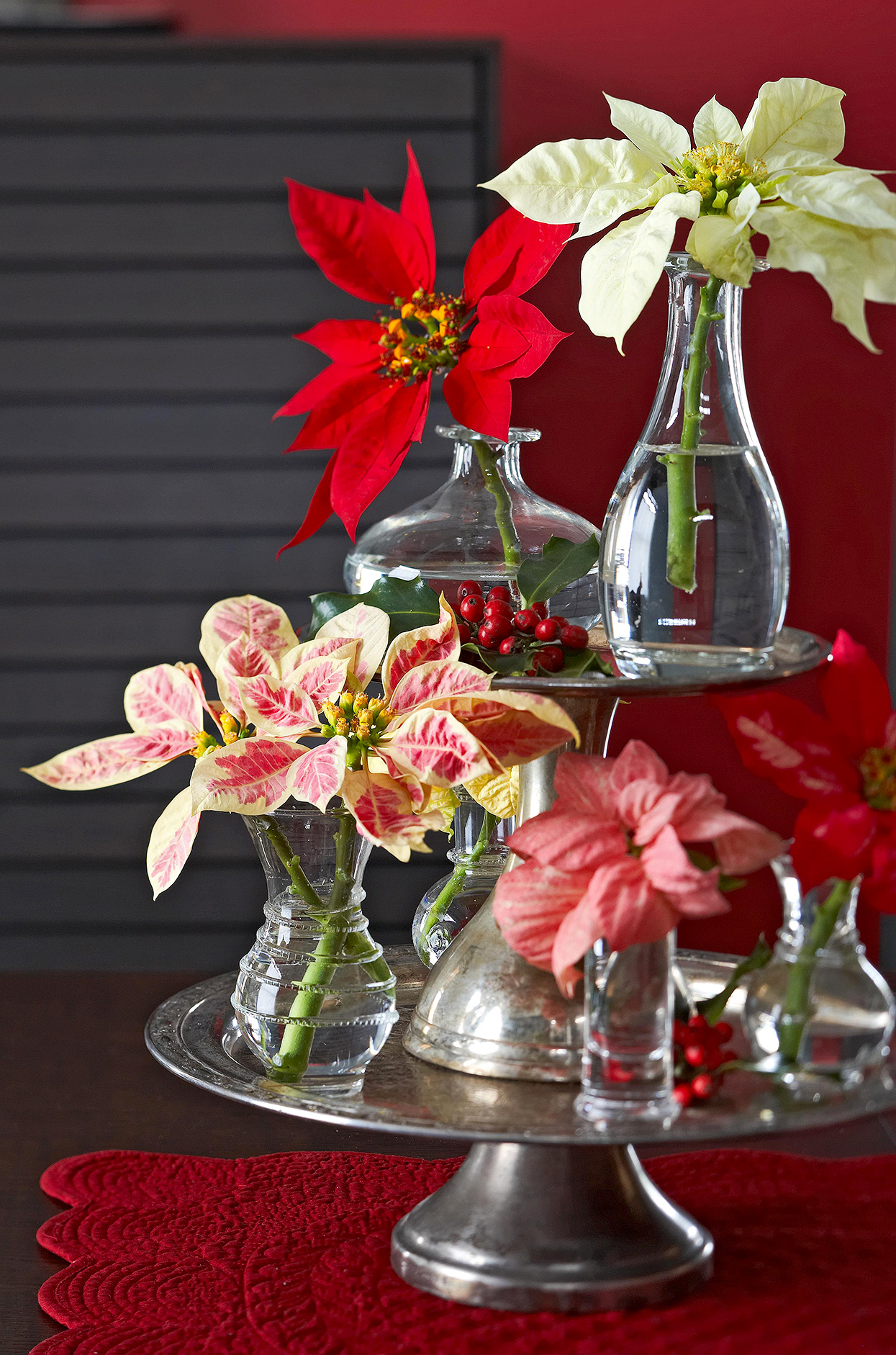 various poinsettia cuttings on tiered stand