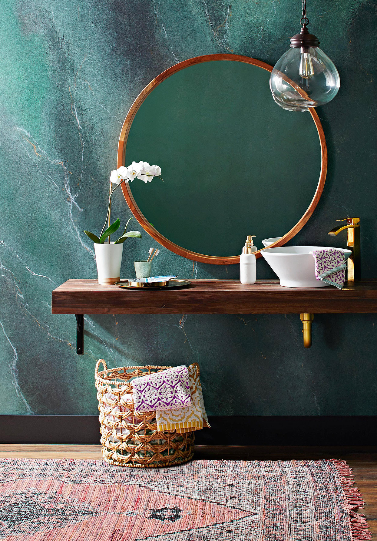 bohemian-style bathroom vanity with green marbled wall effect
