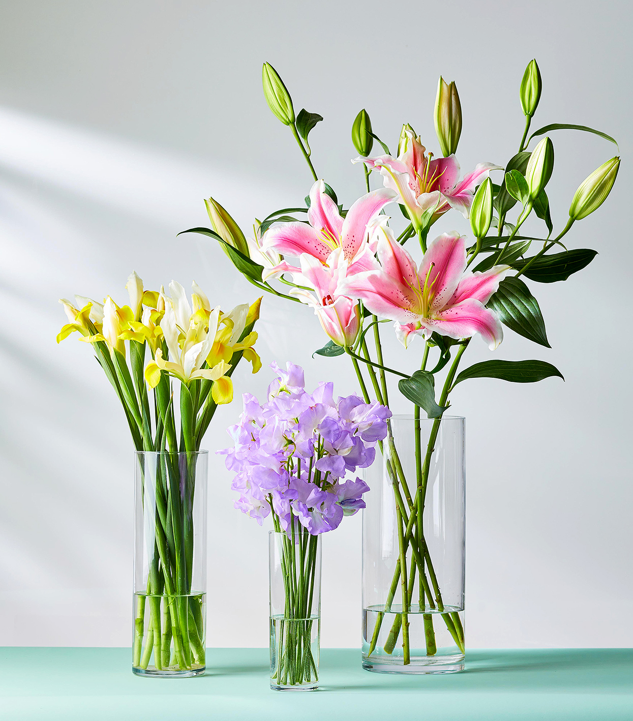 cylinder vases with long-stemmed flowers