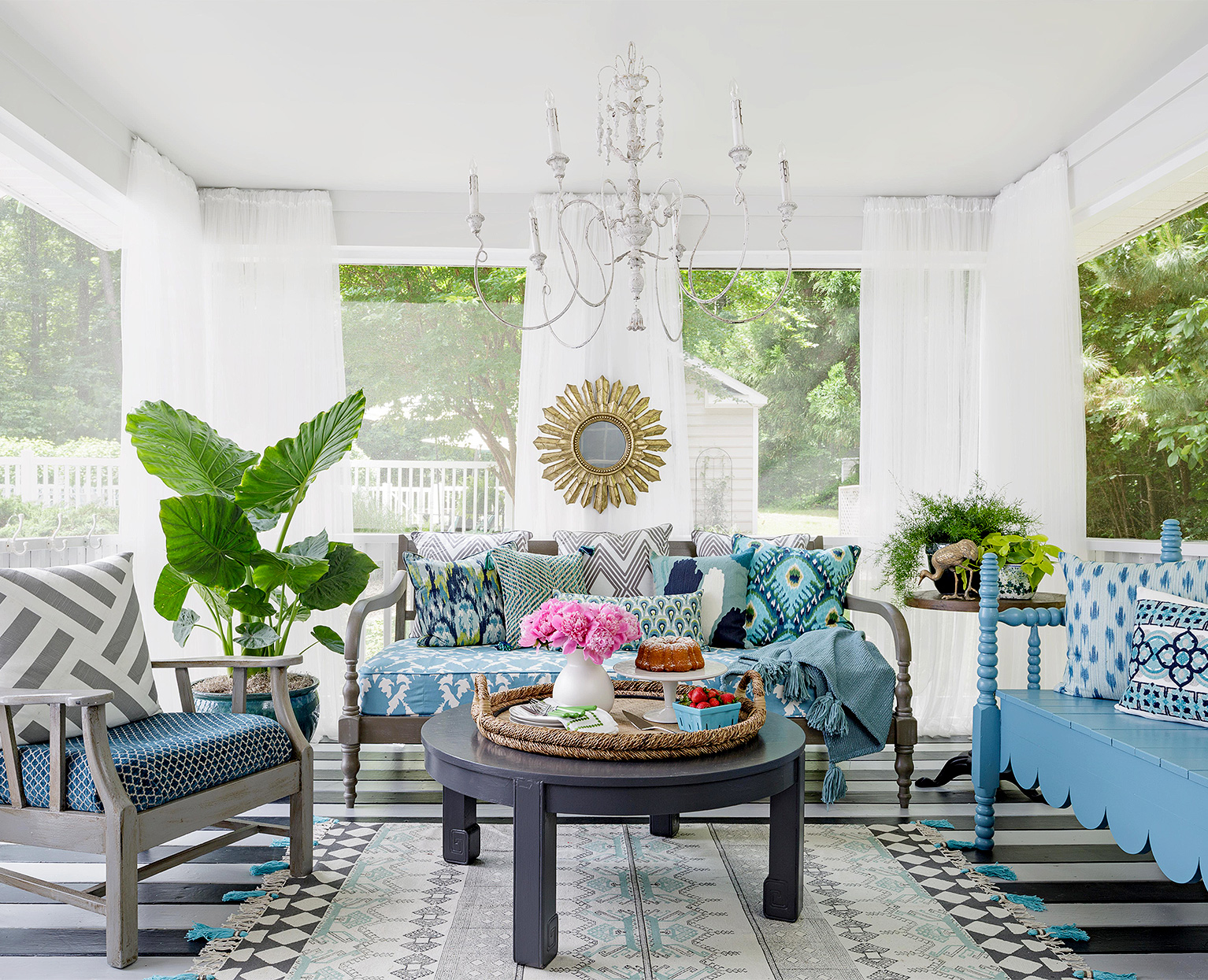 enclosed porch with blue textiles and white curtains