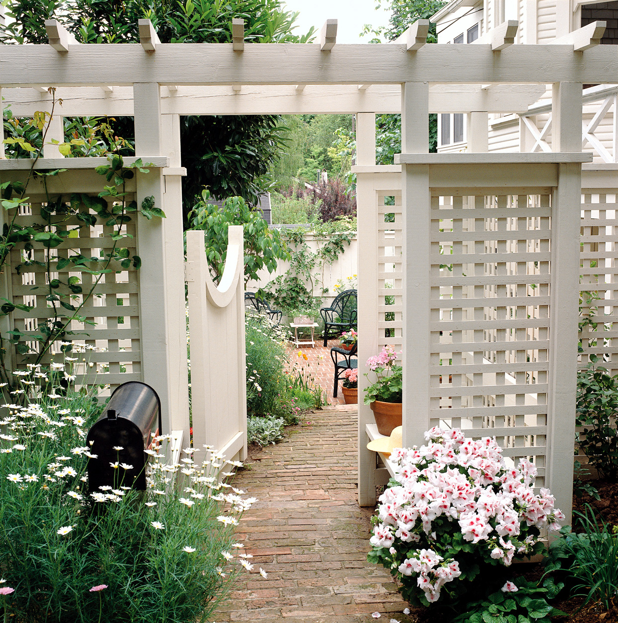 gated arbor white trellis garden