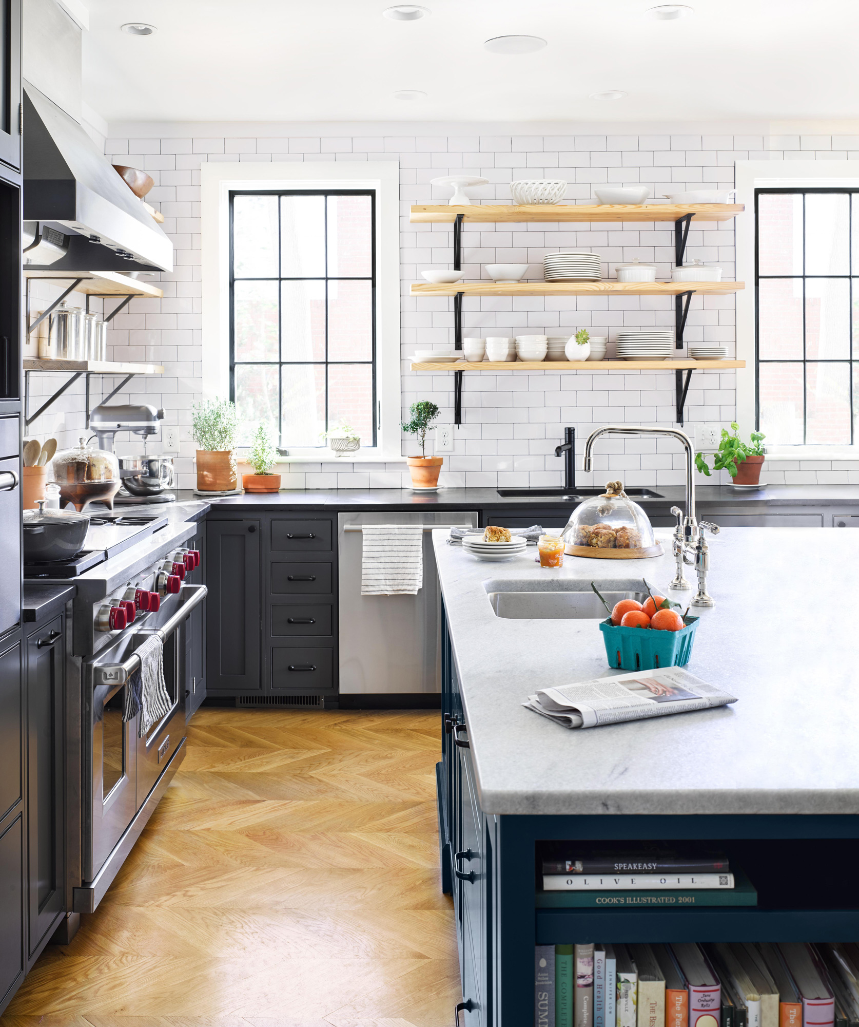 white kitchen with subway tile black cabinets