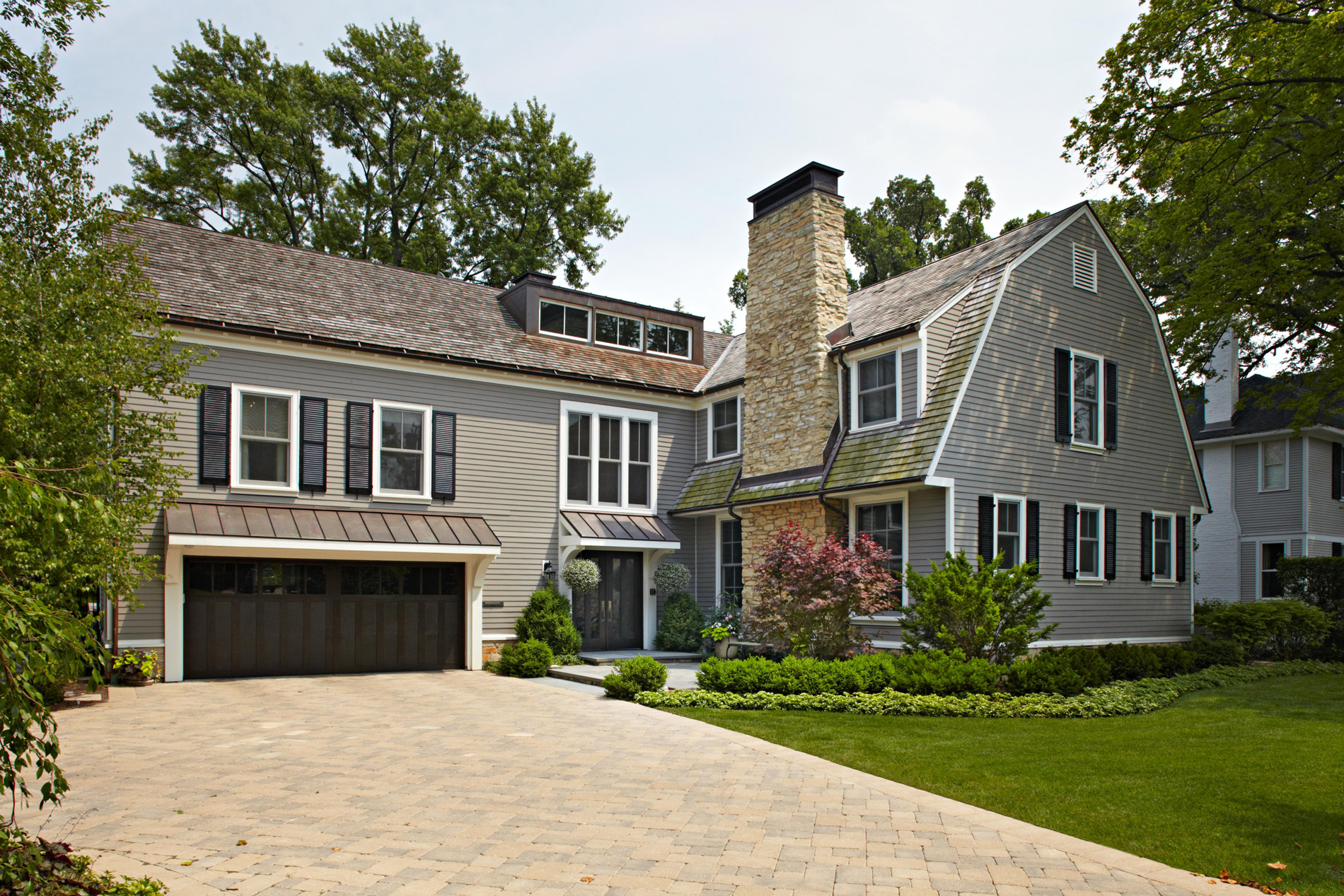 home exterior with stone chimney