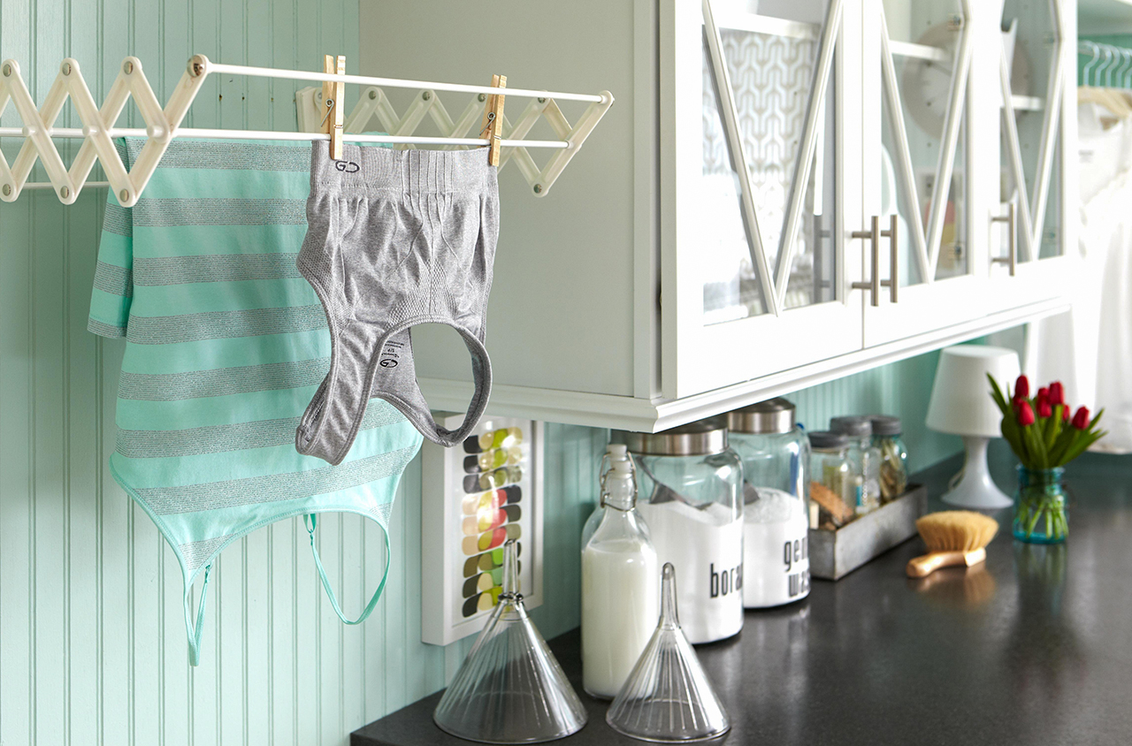 laundry room counter hanging shirts drying