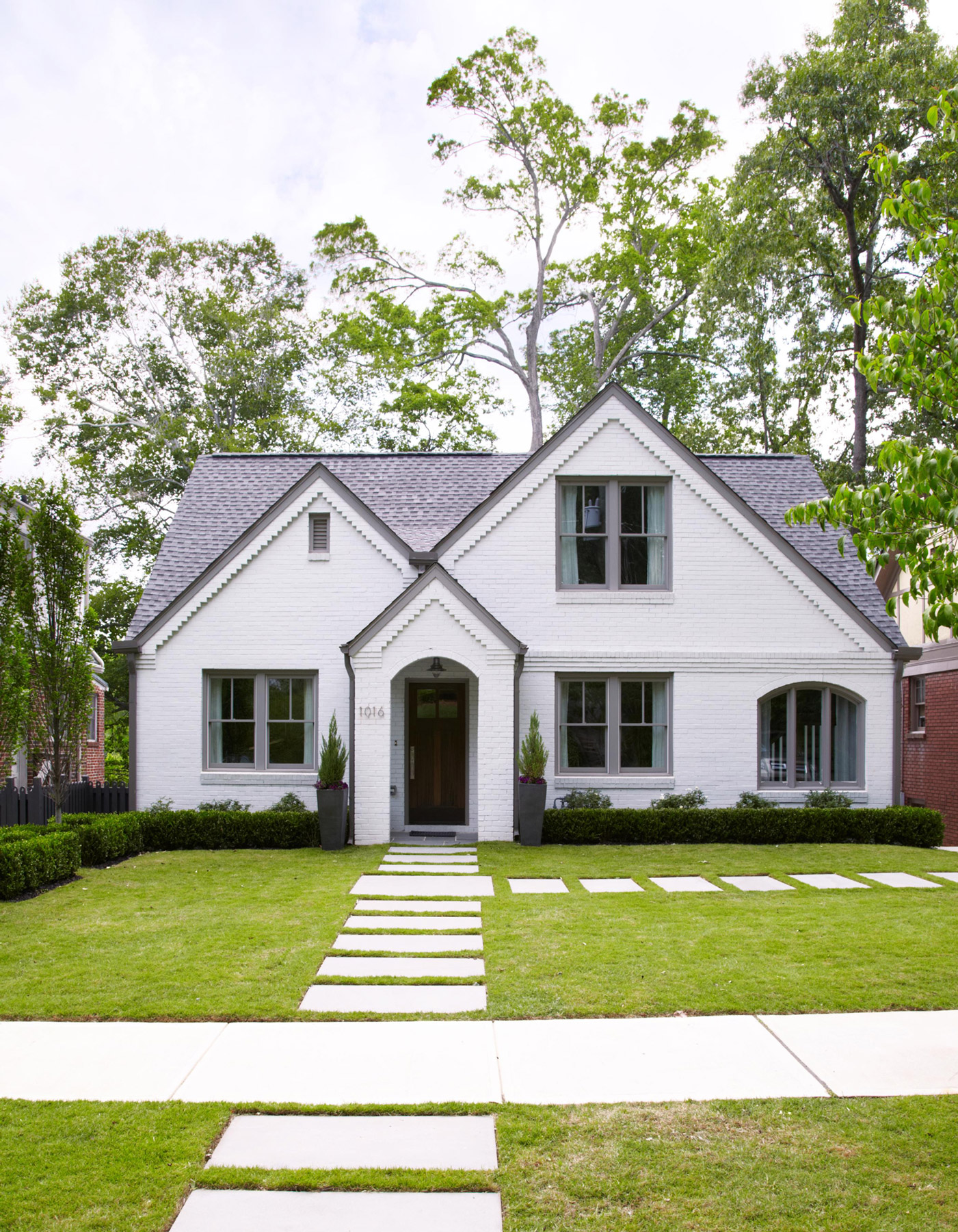 white home exterior with extended portico