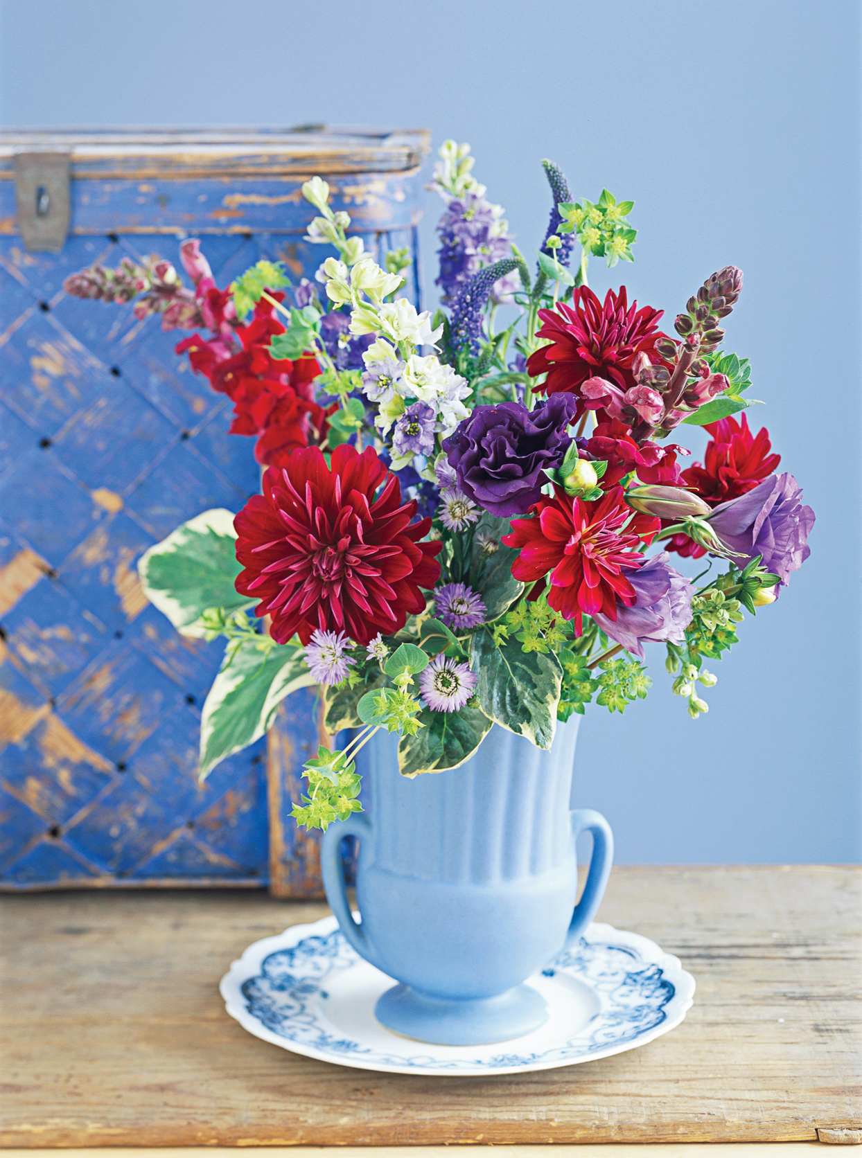 vibrant red purple flower arrangement blue vase