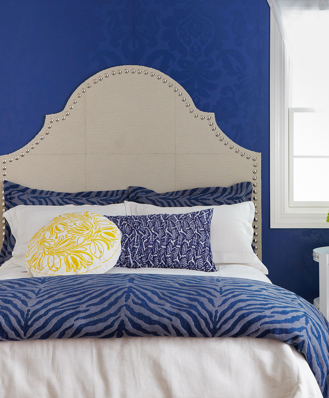 blue bedroom carpeted headboard