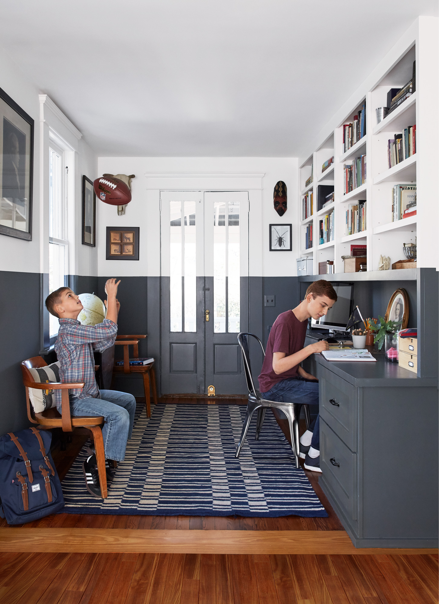 two-tone room boy on bench tossing football boy studying at desk