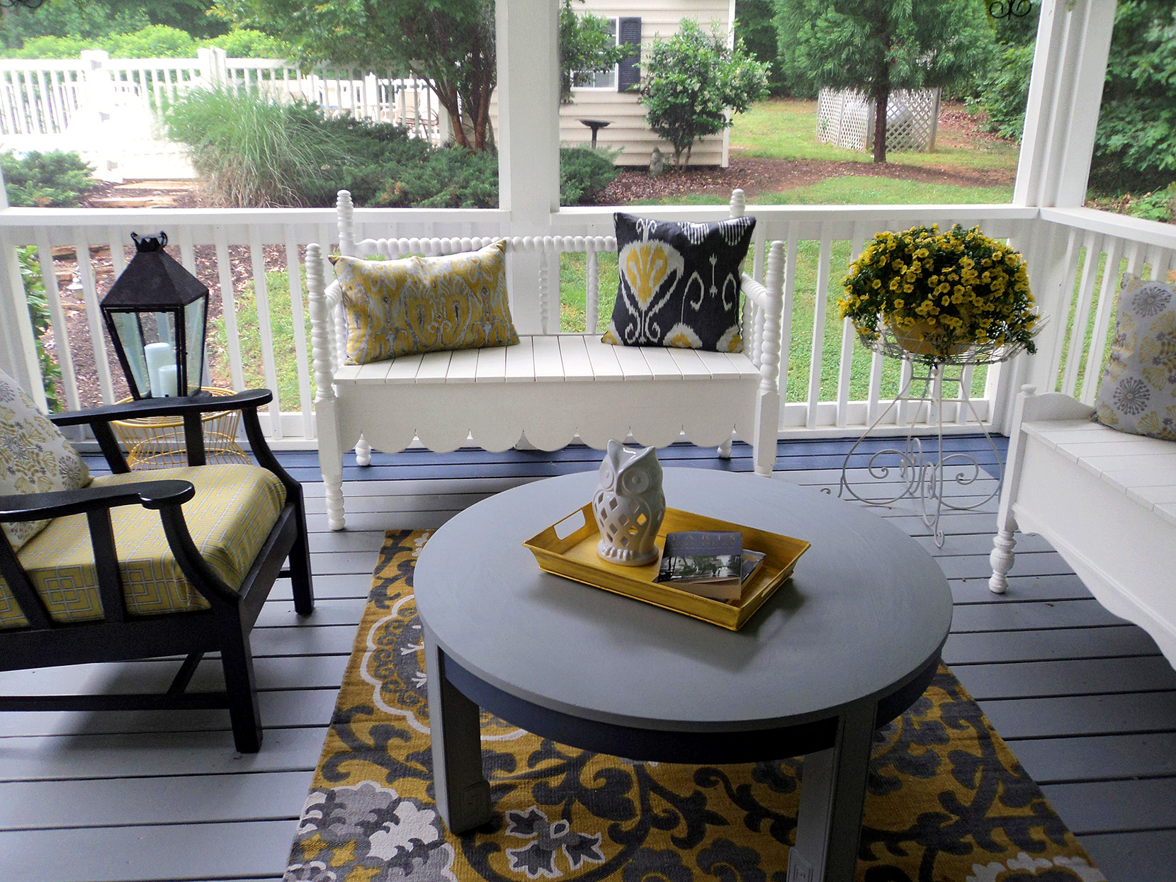 before shot of cottage-style front porch with blue and yellow
