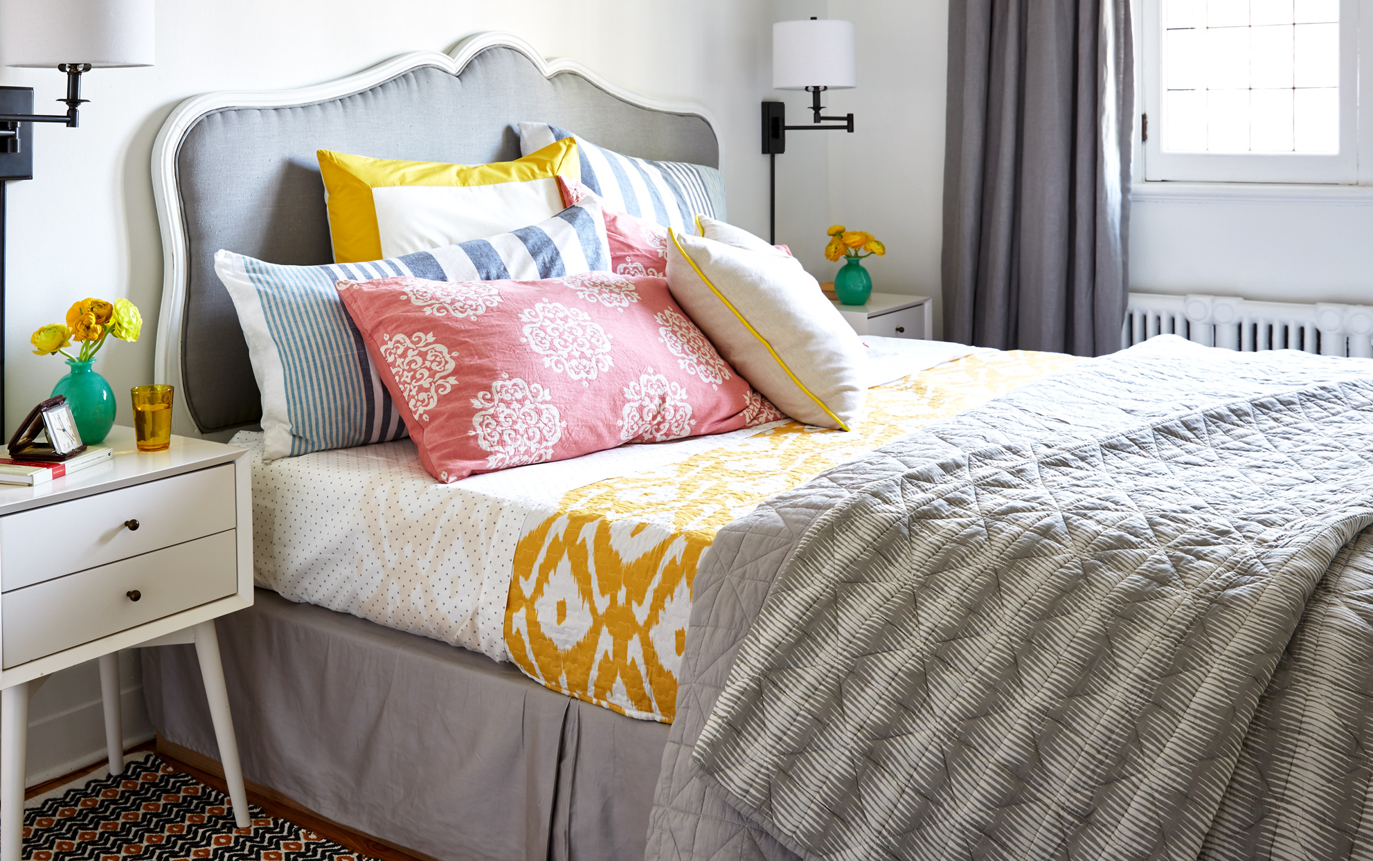 Bed with colorful patterned bedding
