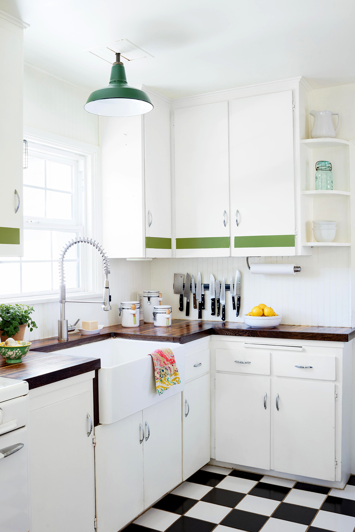 Kitchen with checkered floor and white cabinets