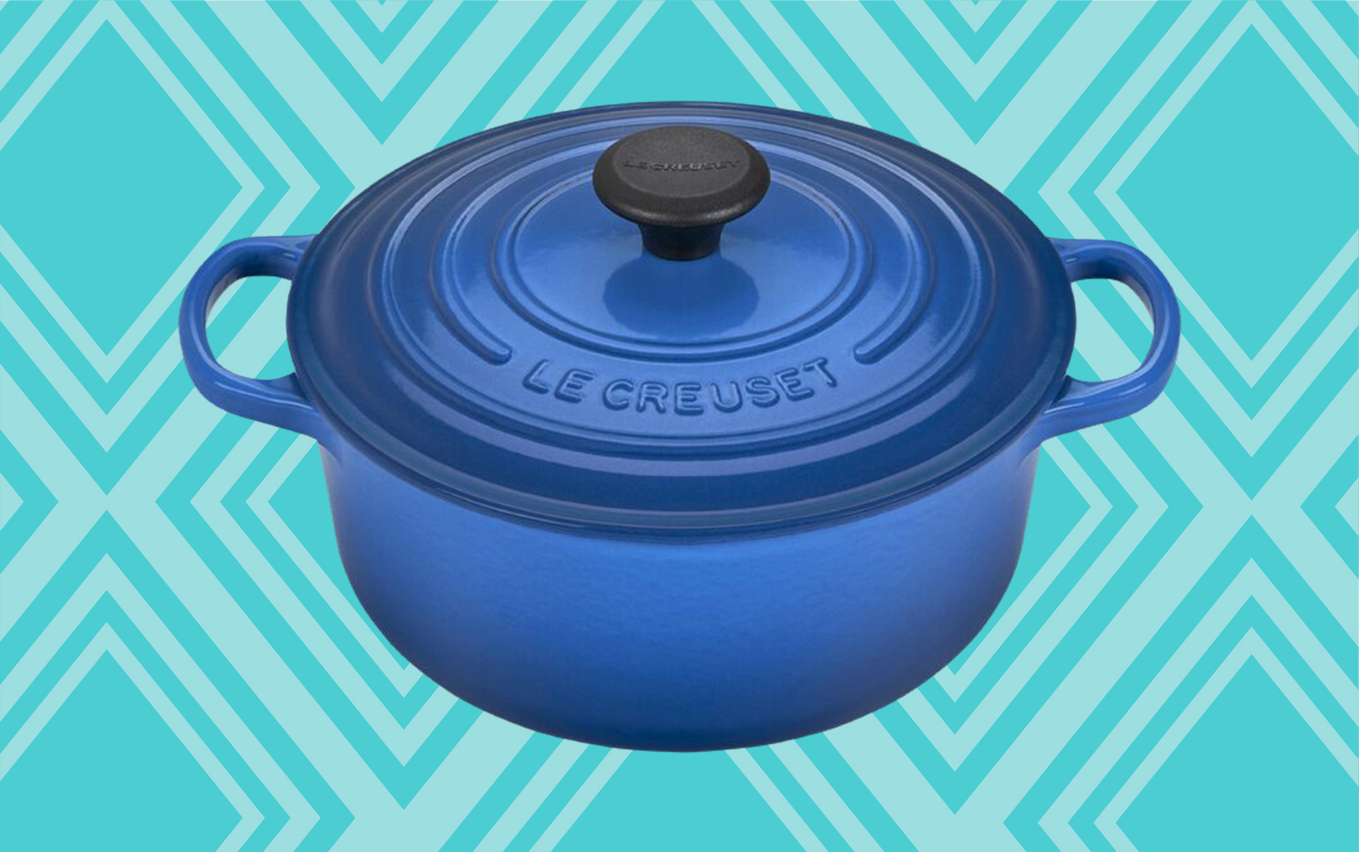 Wayfair blue Le Creuset pan with lid on a teal background