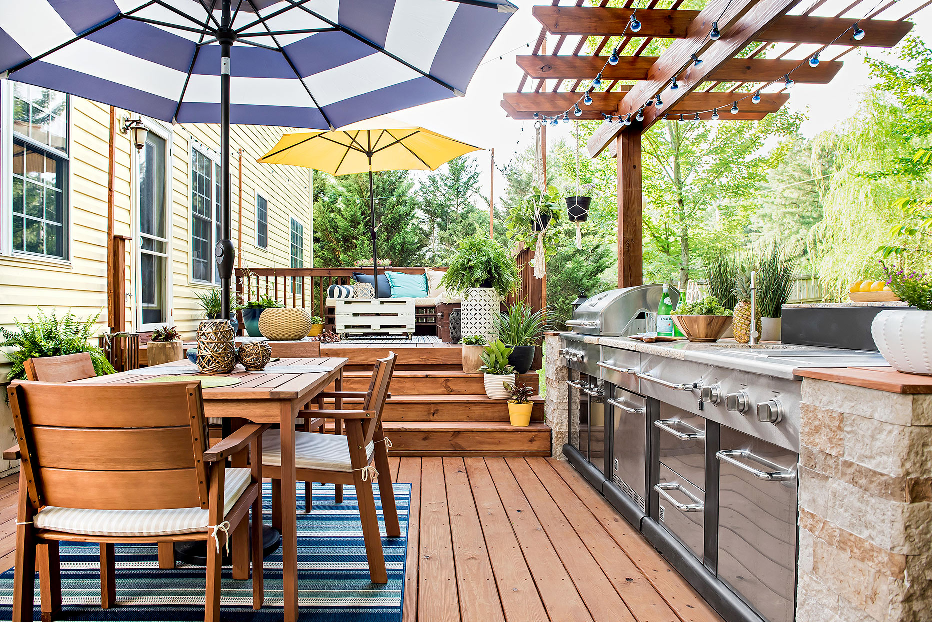multi-level back deck with outdoor dining, kitchen and lounge areas