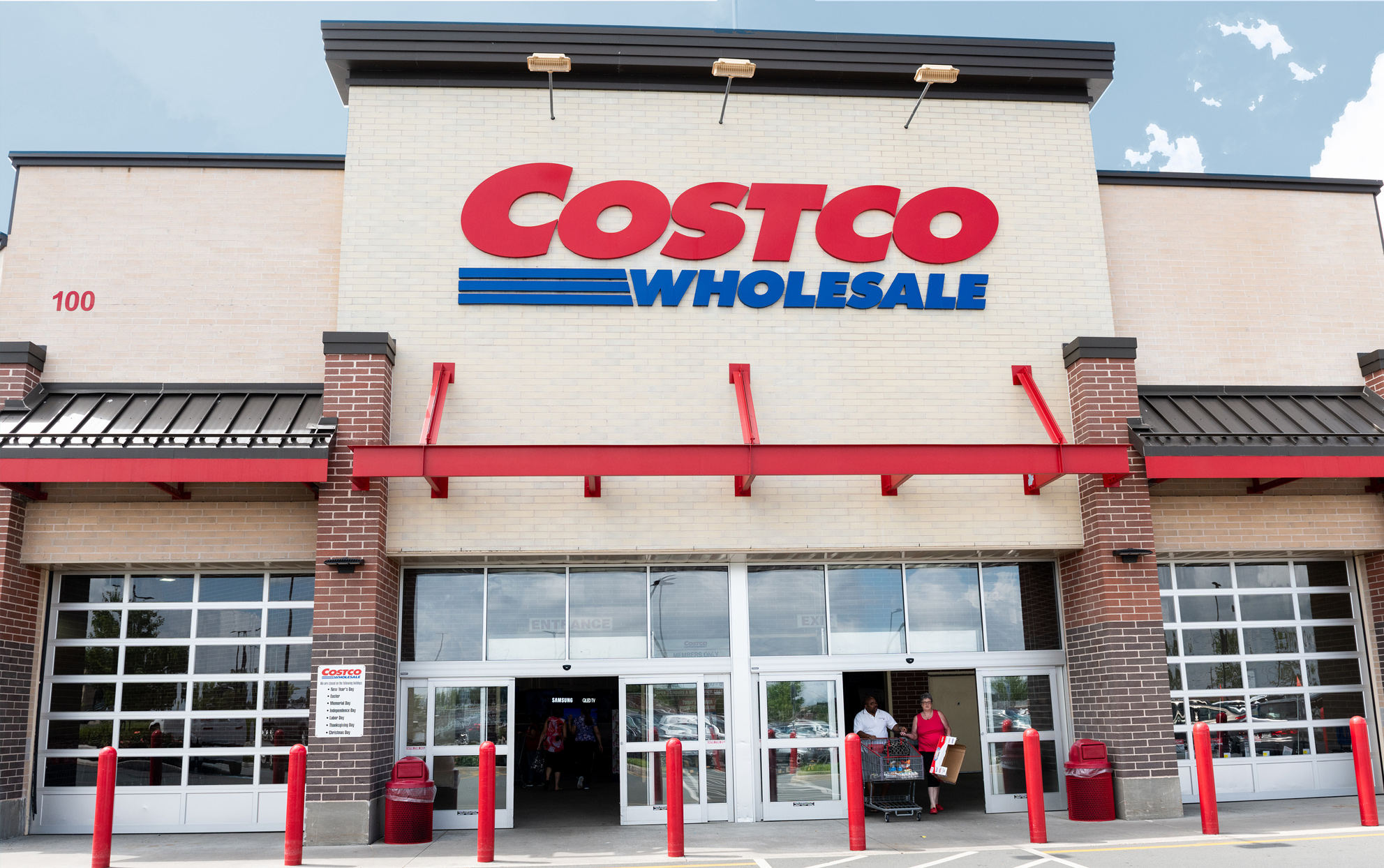 Costco storefront with customers exiting front door