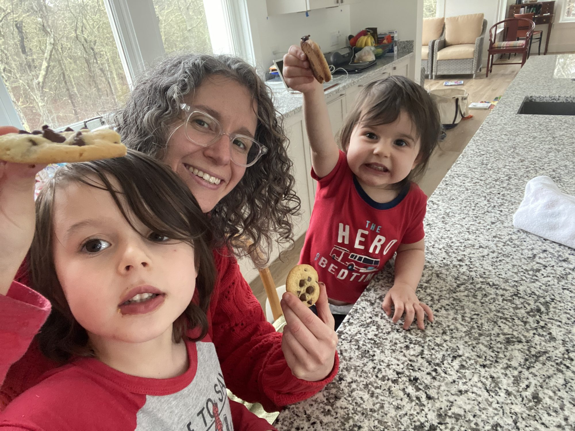 mom and two kids baking cookies