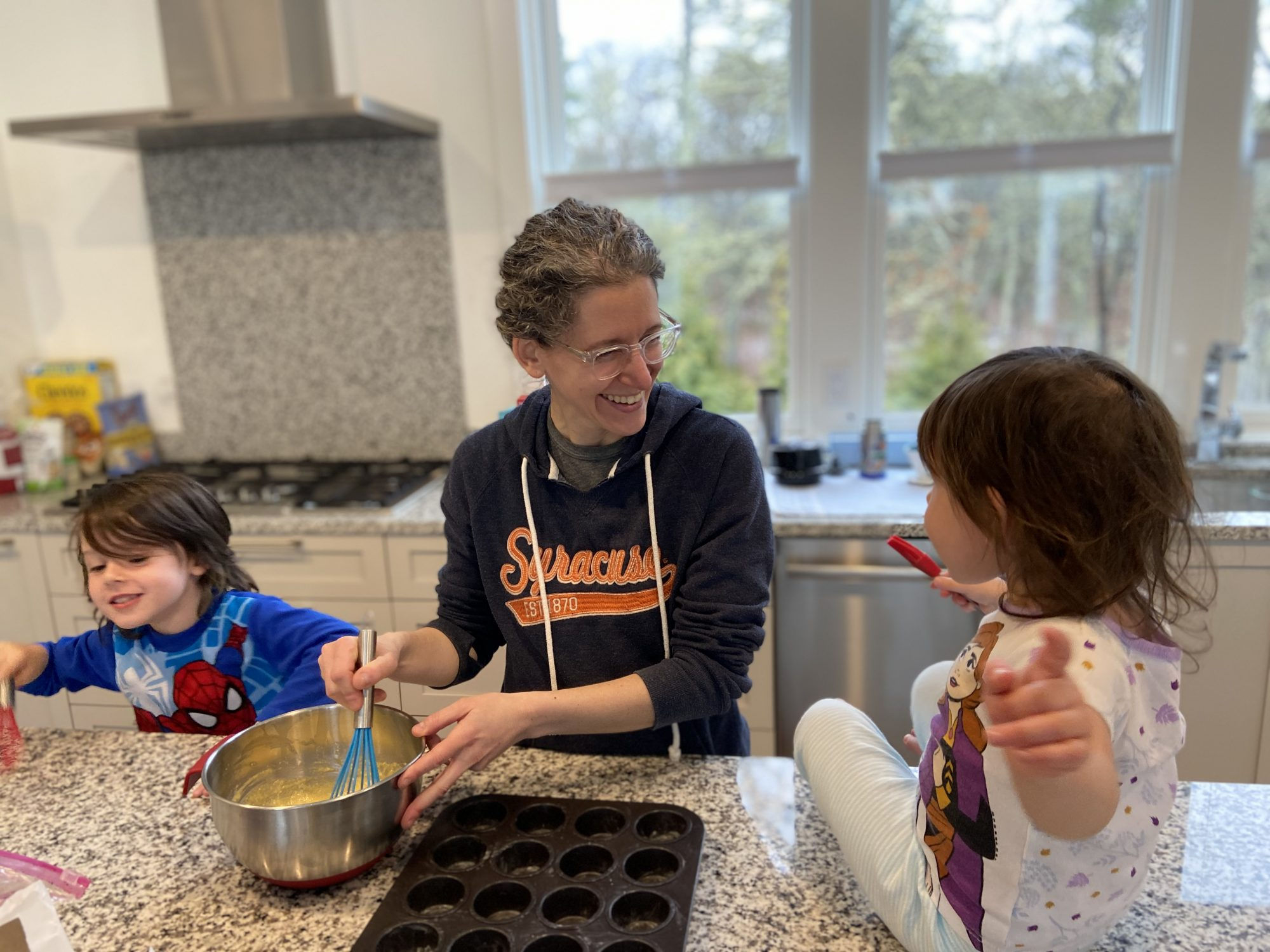 mom and kids baking muffins