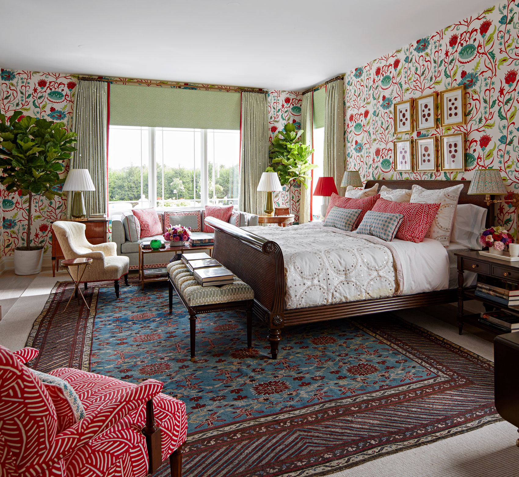 bedroom with seating area and colorful floral wallaper