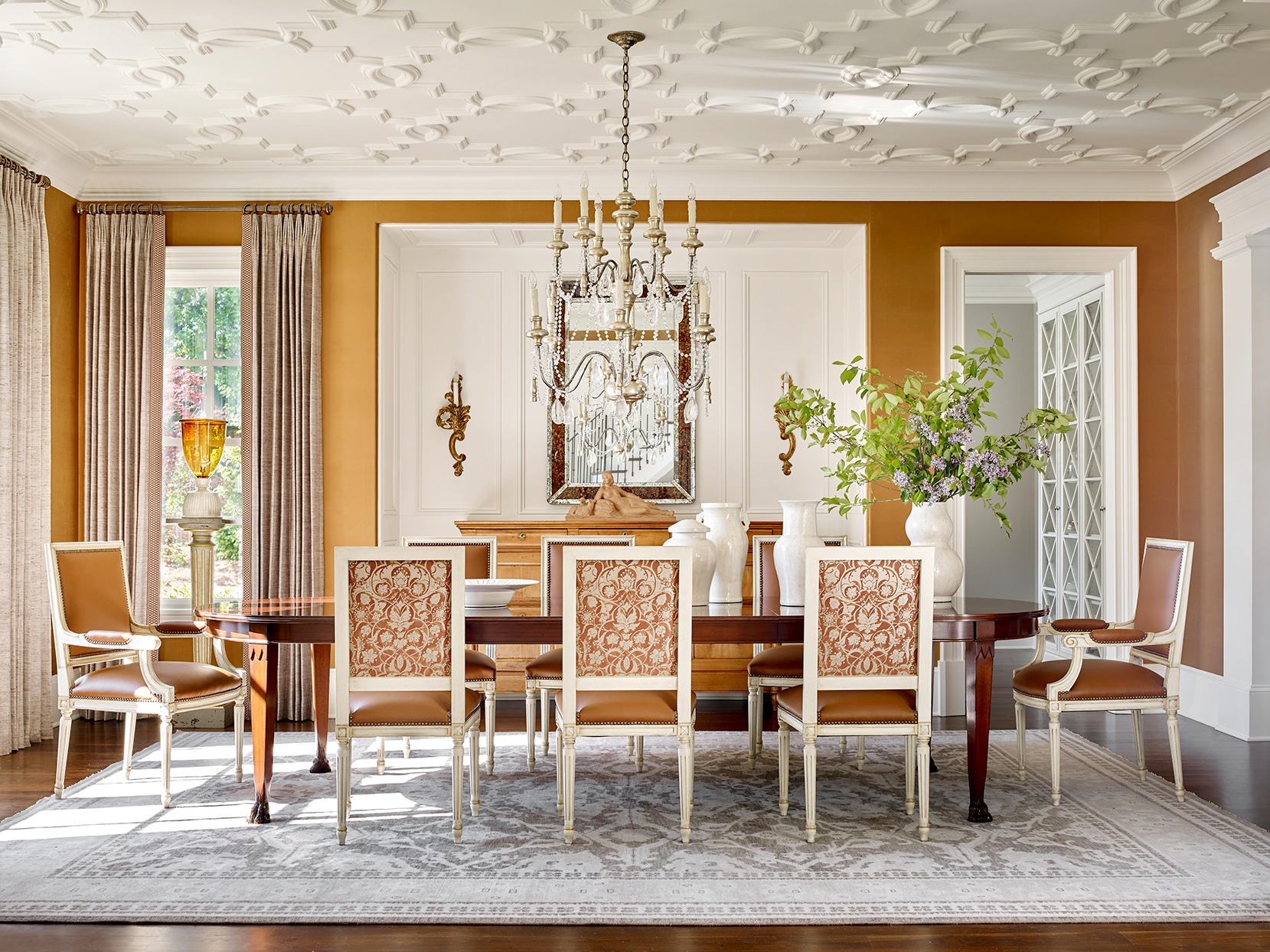 Dining area with patterned chairs