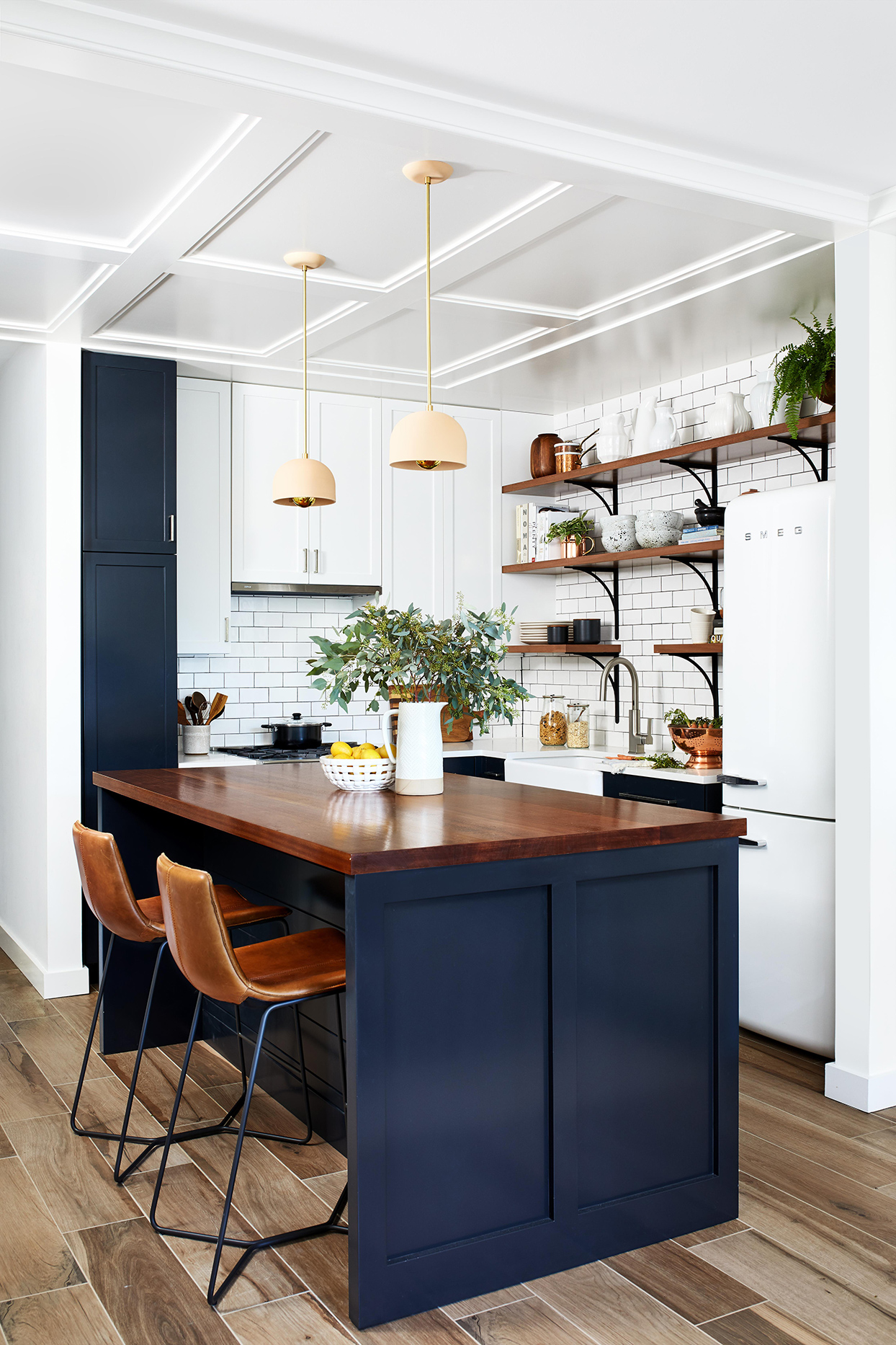white kitchen with dark blue and wood accents