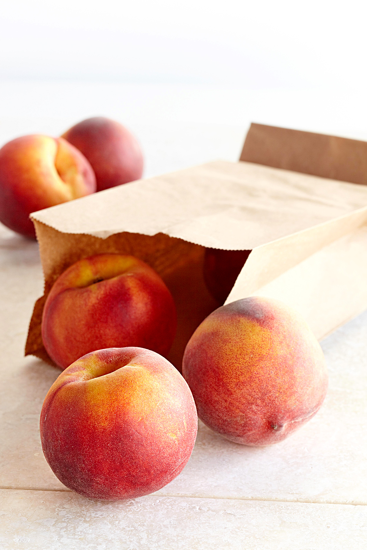 peaches in a paper bag