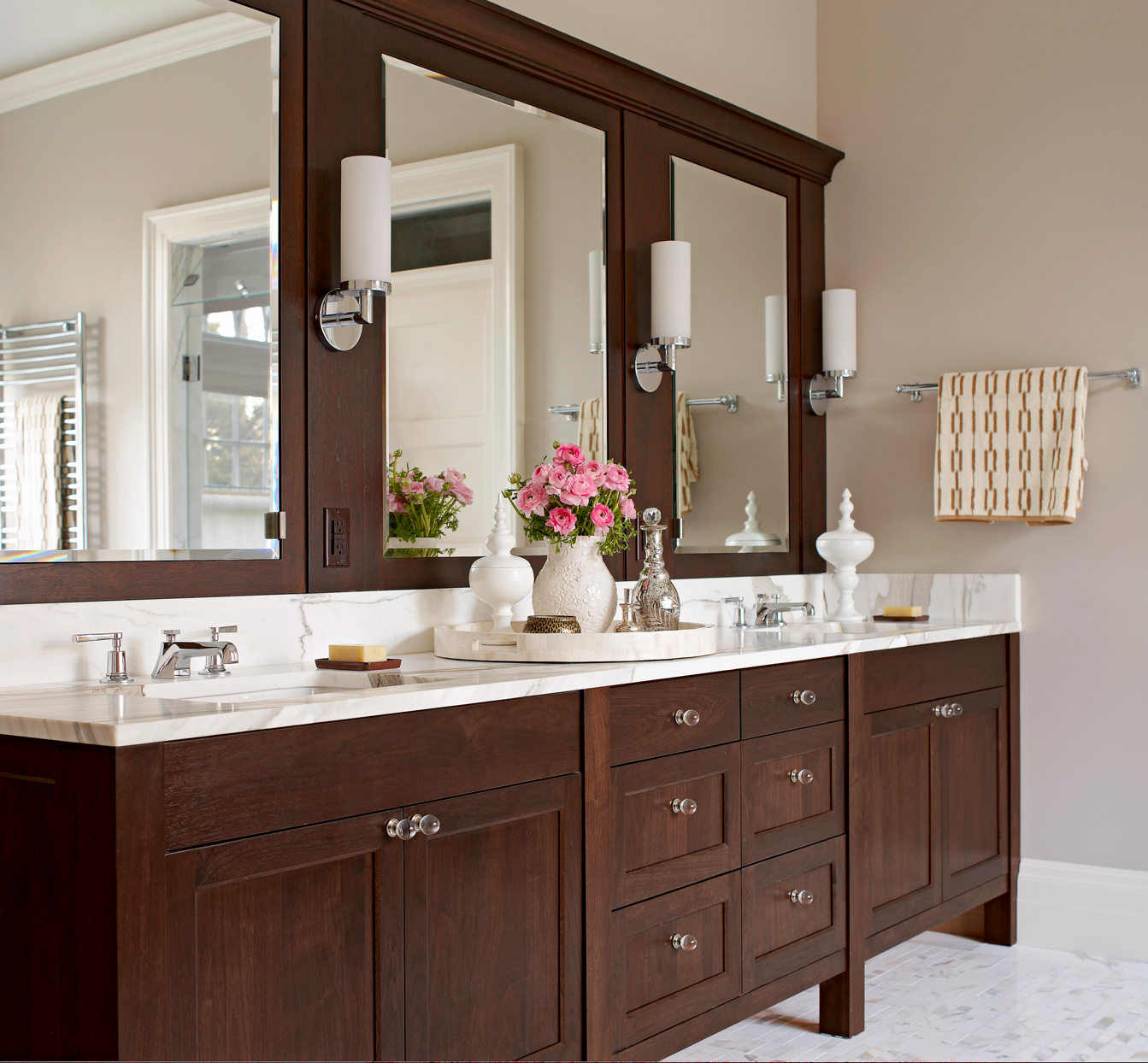 bathroom with walnut cabinetry