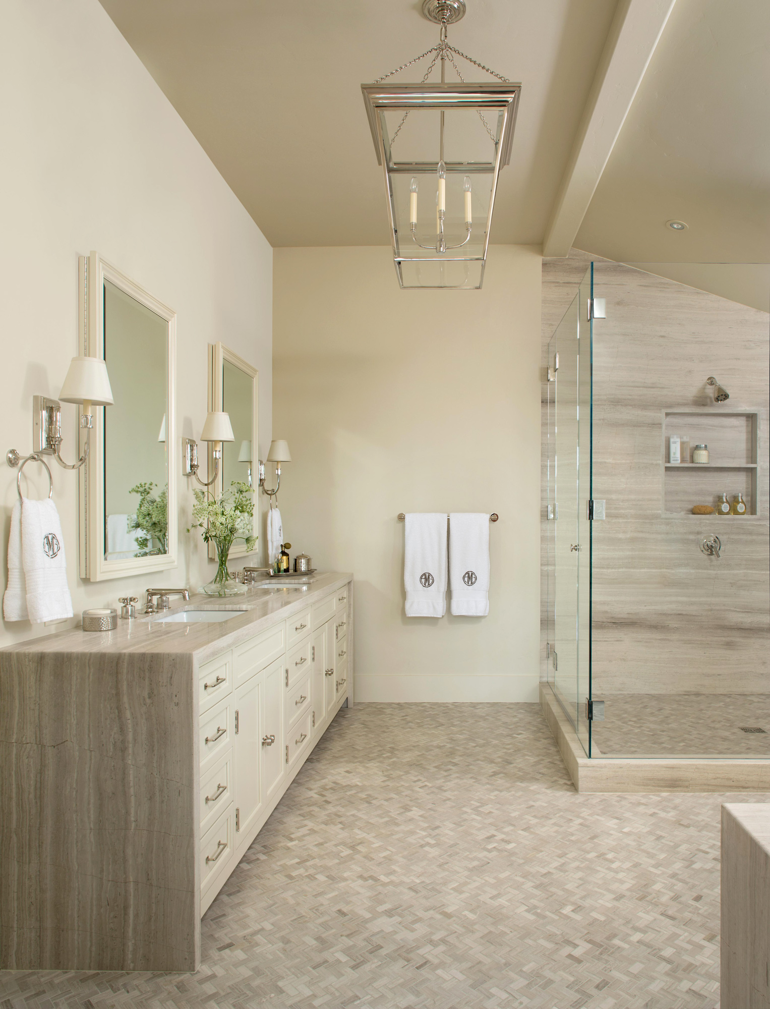 large bathroom with long vanity and glass shower