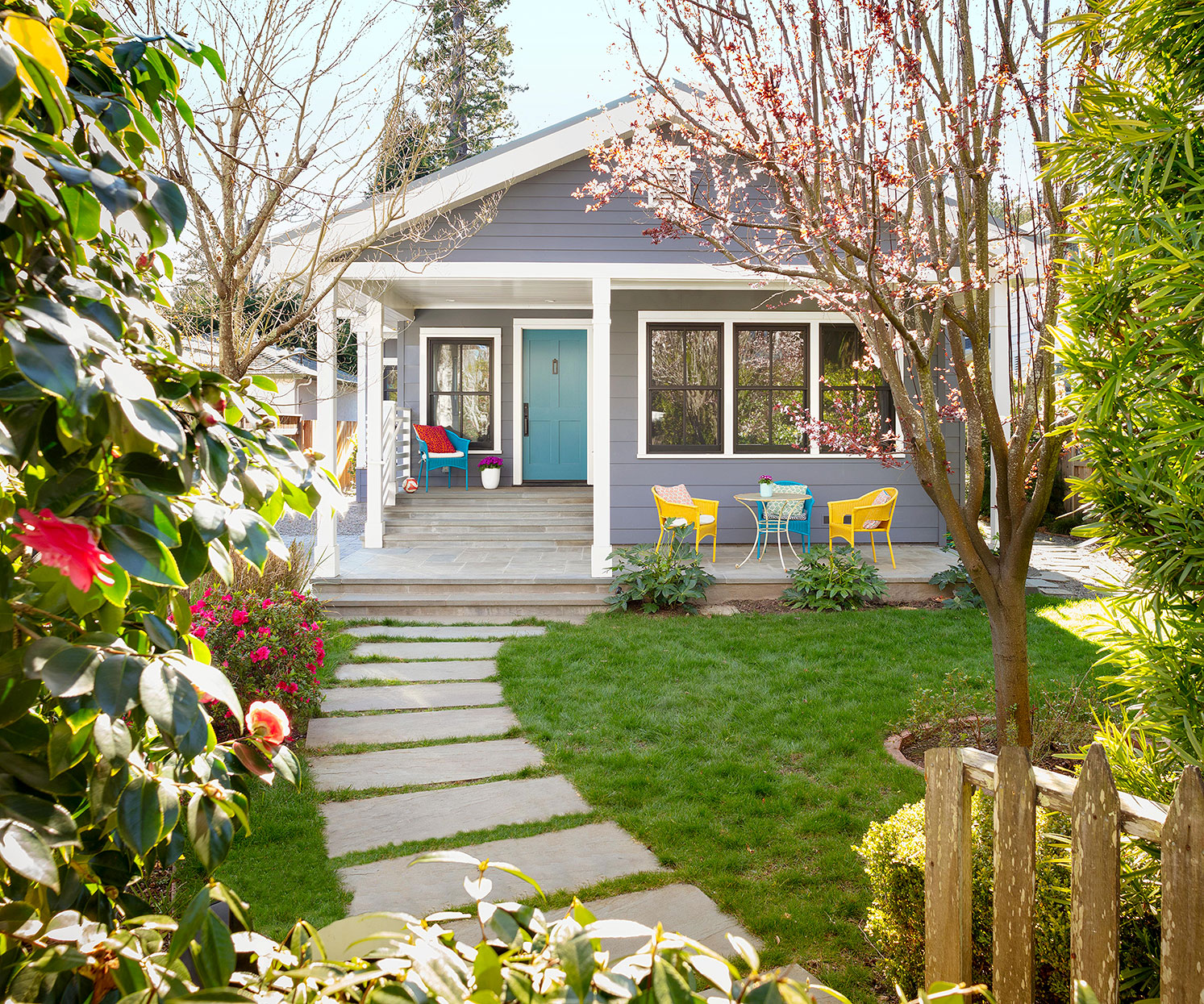gray home exterior patio with white trim and path