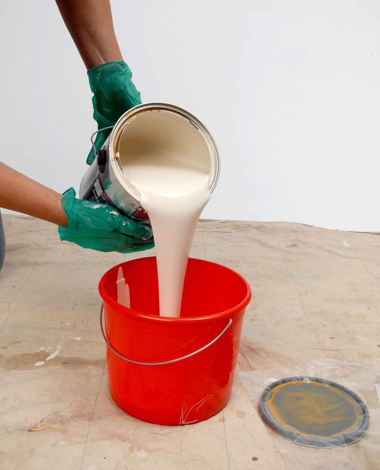 pouring paint into bucket