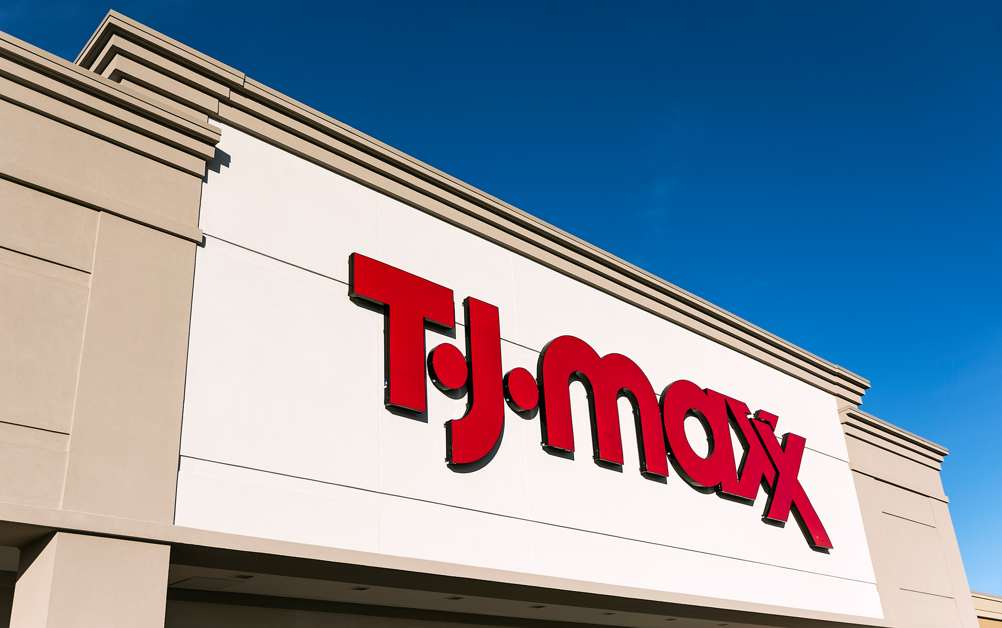 TJ Maxx storefront with blue sky