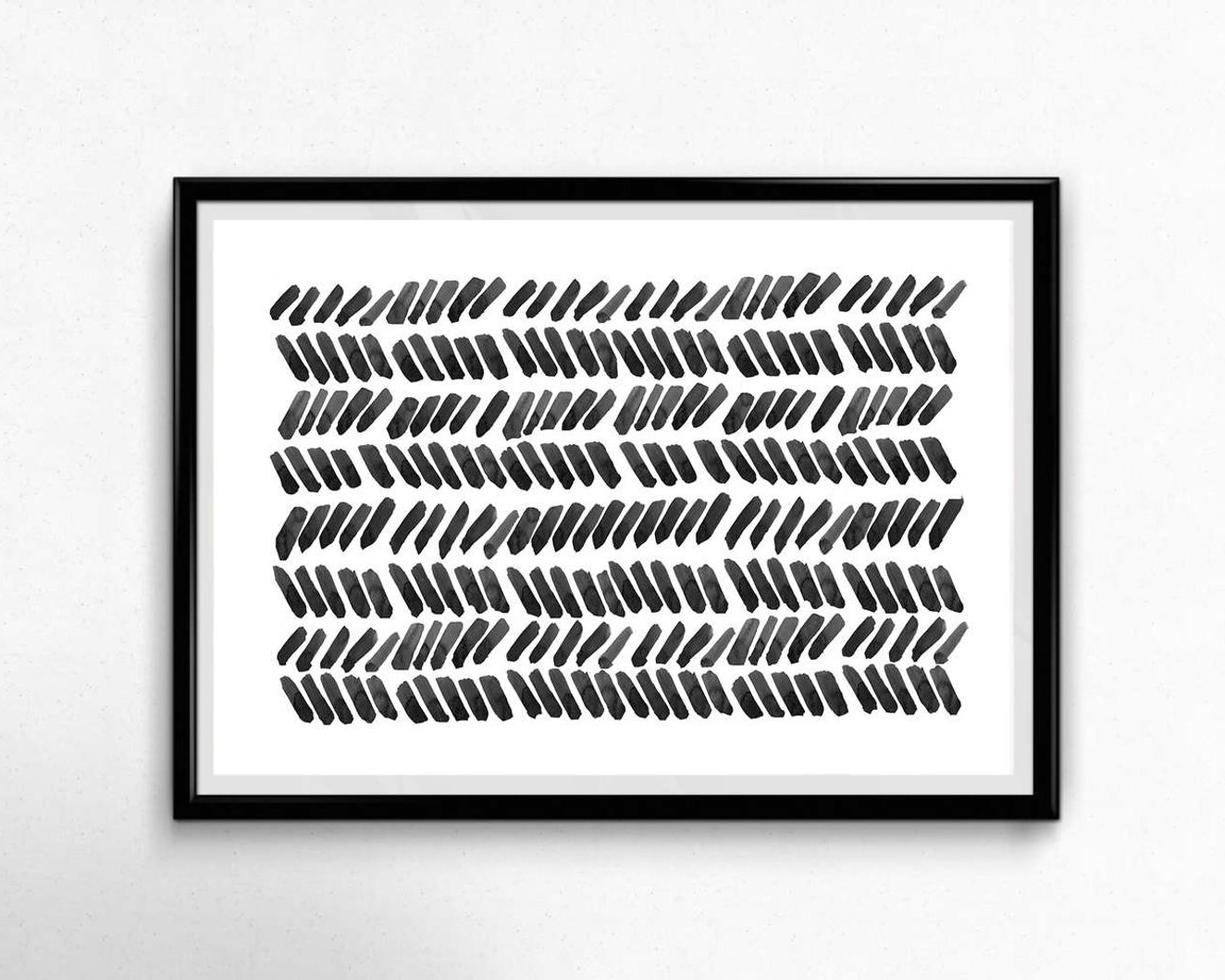 framed black and white art with abstract design