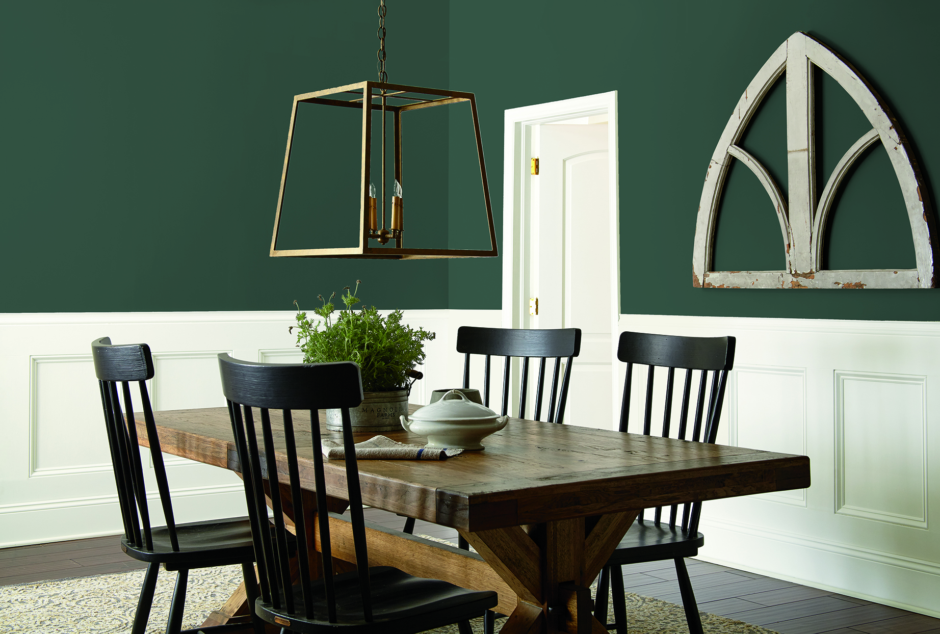 dining room with green walls and white wainscoting