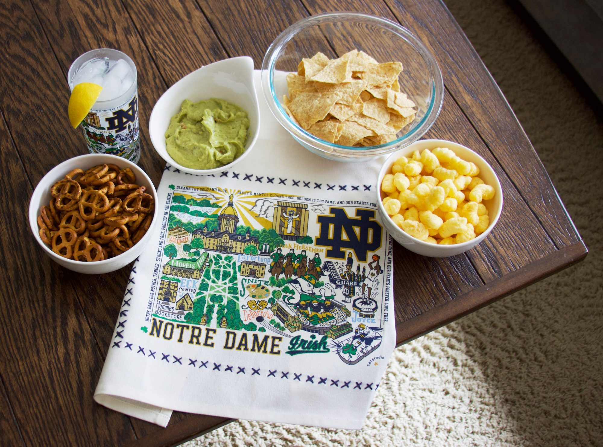 notre dame patterned towel on a table with chips and dip
