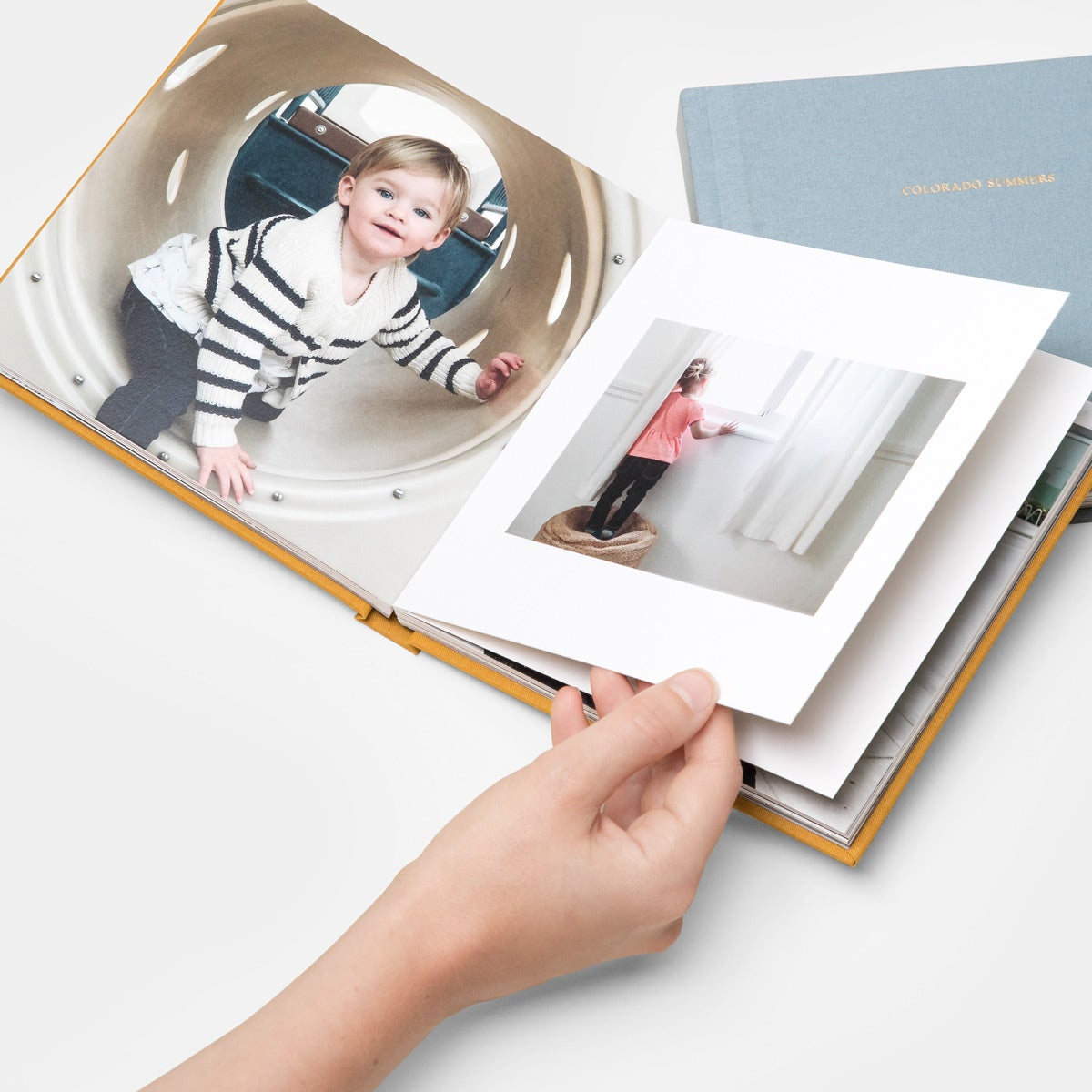 photo book with children's photos inside
