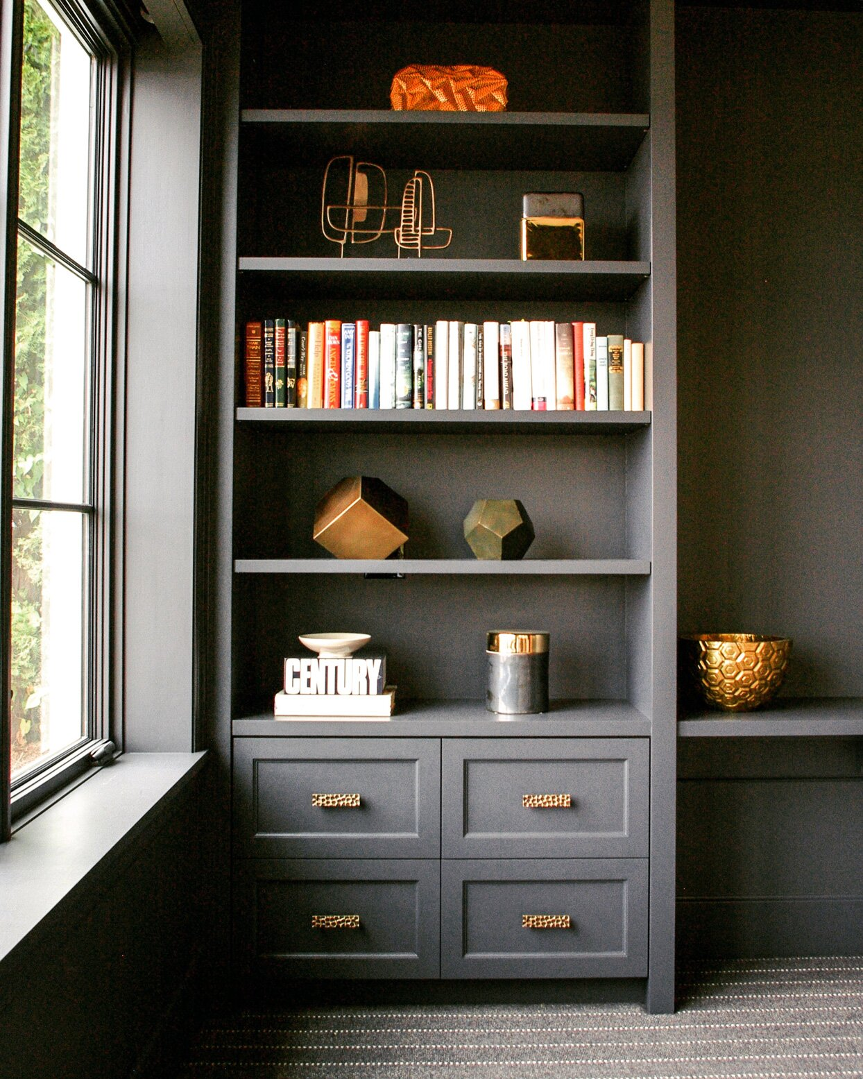 grey bookshelf and window
